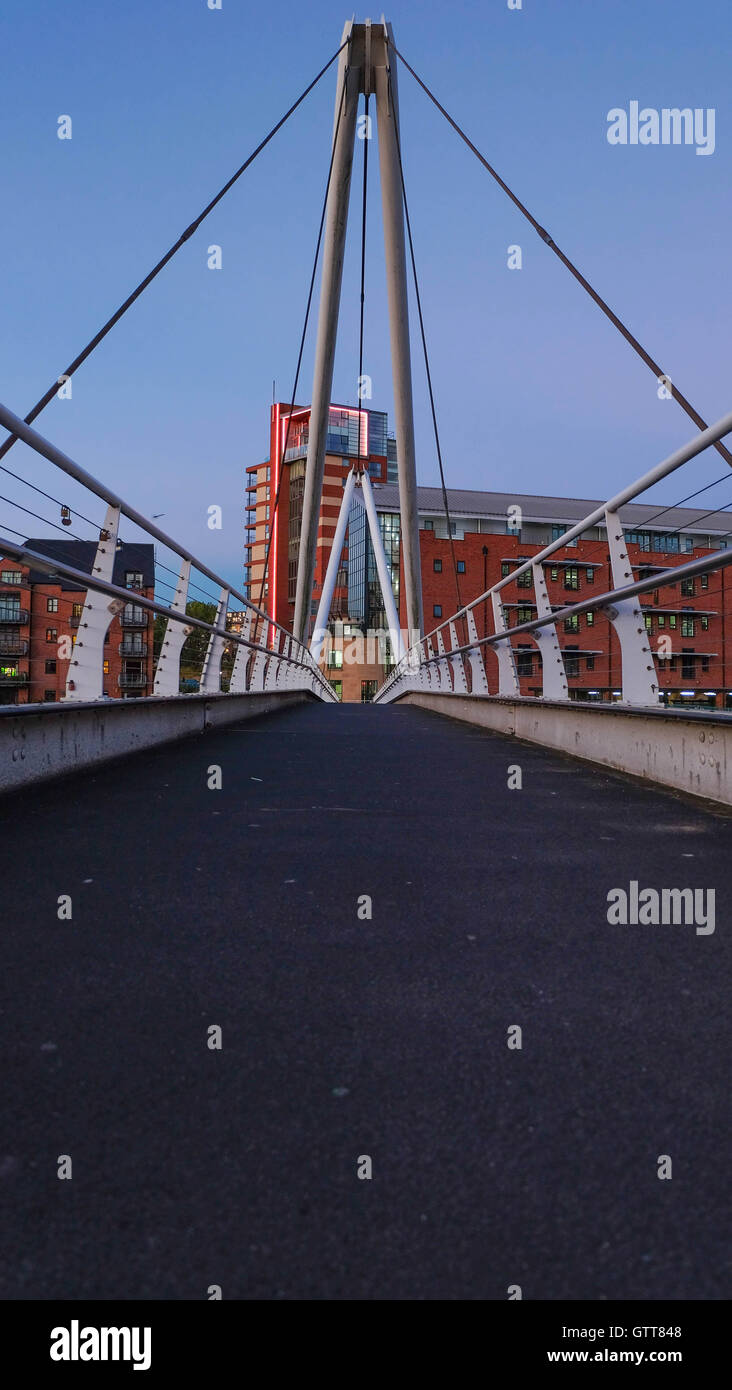 Footbridge at Clarence Dock at dusk, Leeds - Stock Image