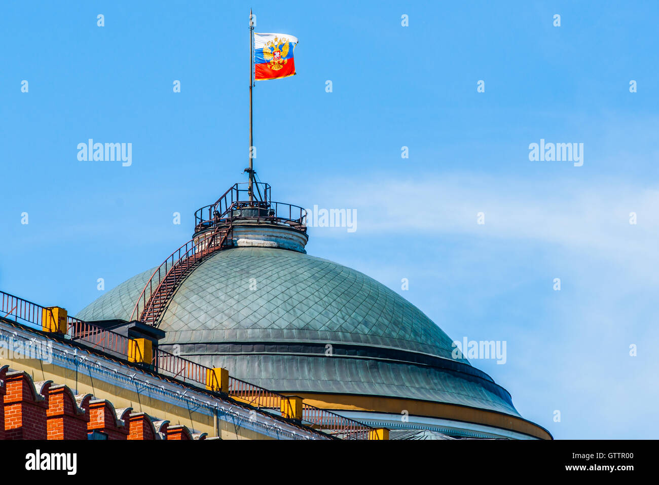 Dome of the Senate building of Moscow Kremlin and the three color flag - the President of the Russian Federation - Stock Image