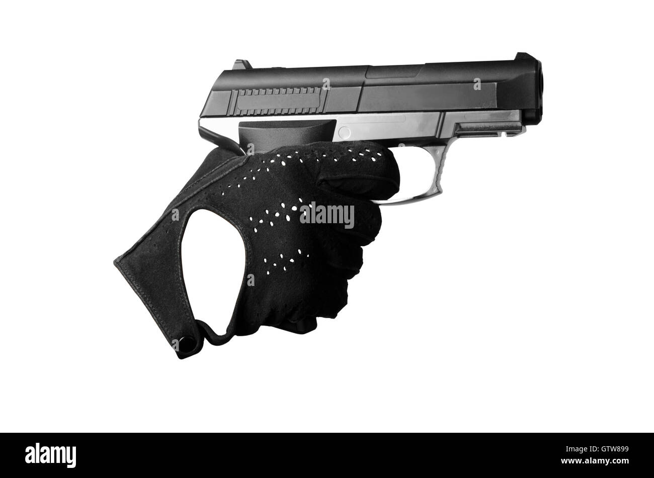 hand with a pistol in a black glove aim and pulled the trigger - Stock Image