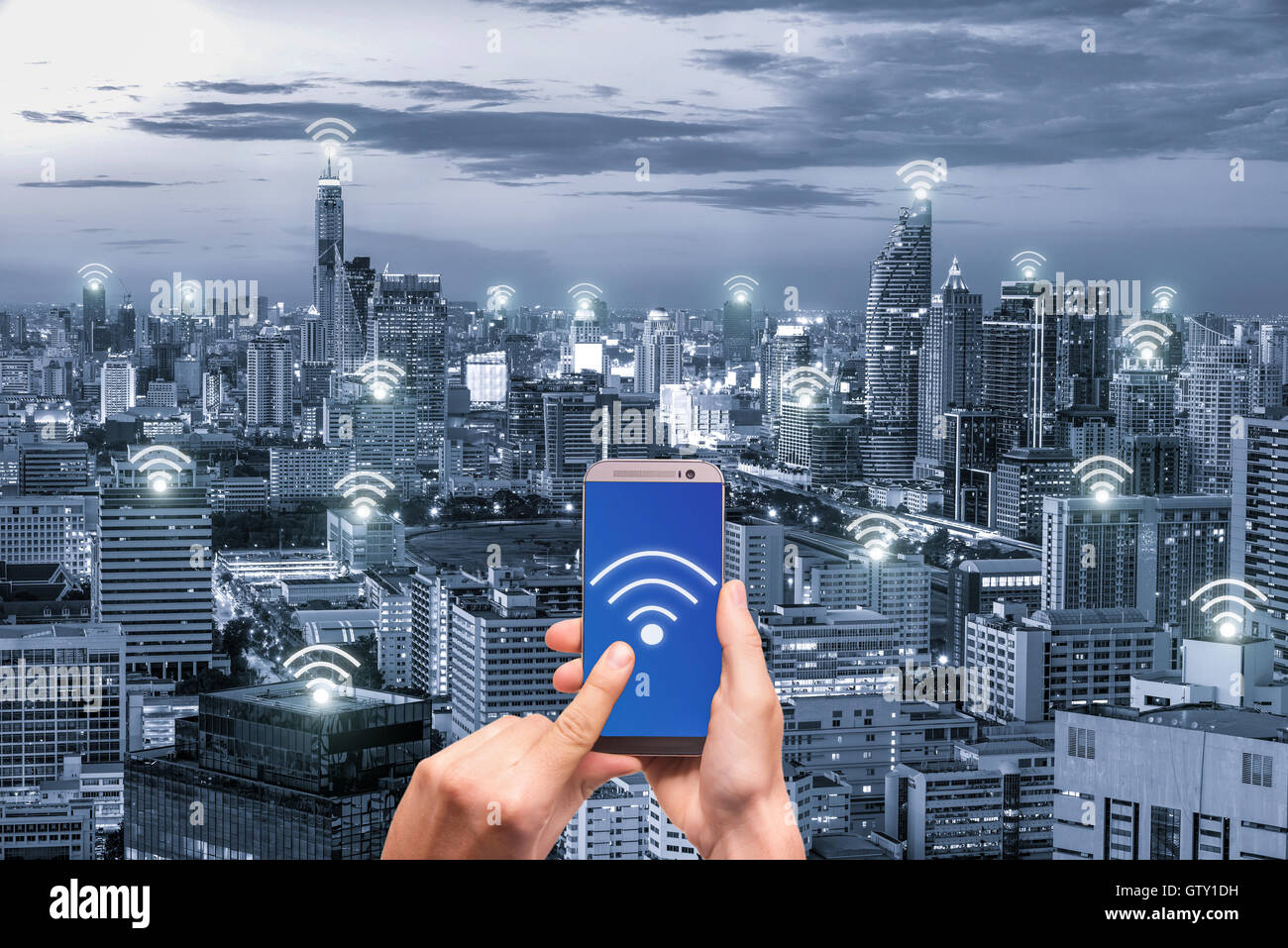 Hand holding mobile phone with wifi network connection network. Wifi network connection concept. - Stock Image
