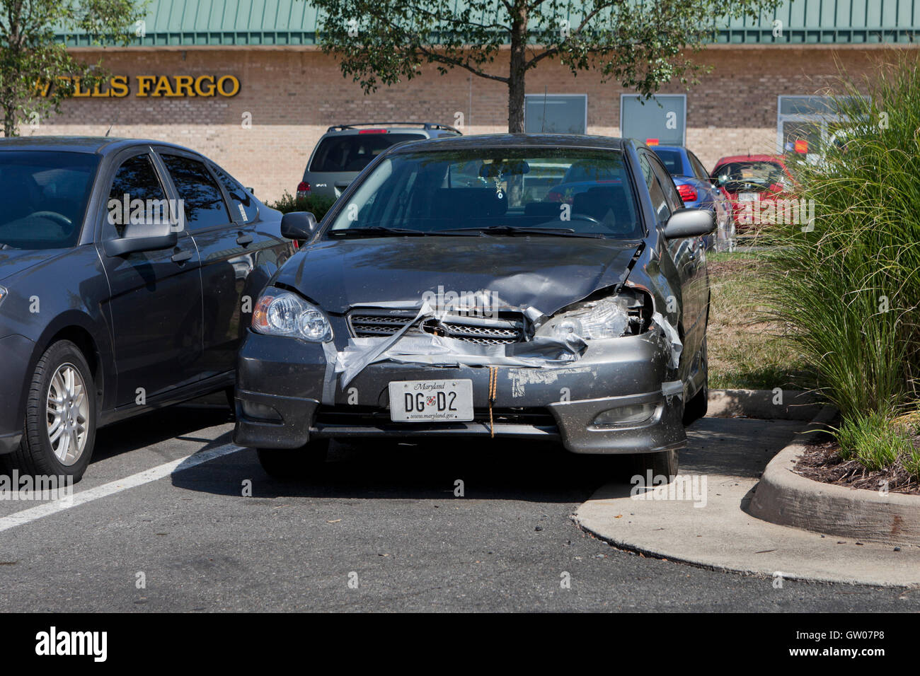 Frontal accident damage of compact Japanese car - USA - Stock Image