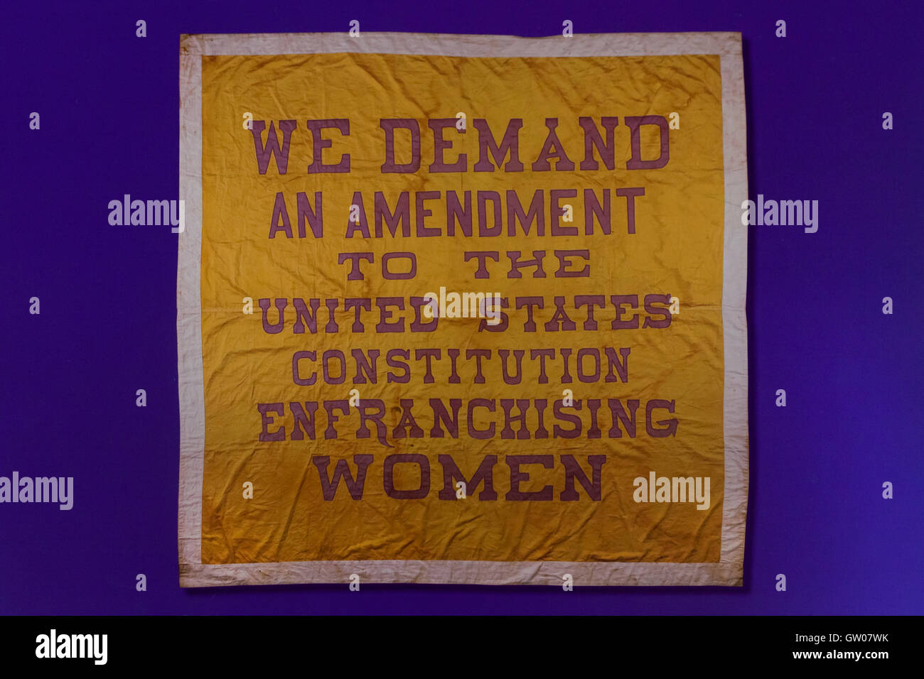 Banner with message 'We Demand an Amendment to the United States Constitution Enfranchising Women' during - Stock Image