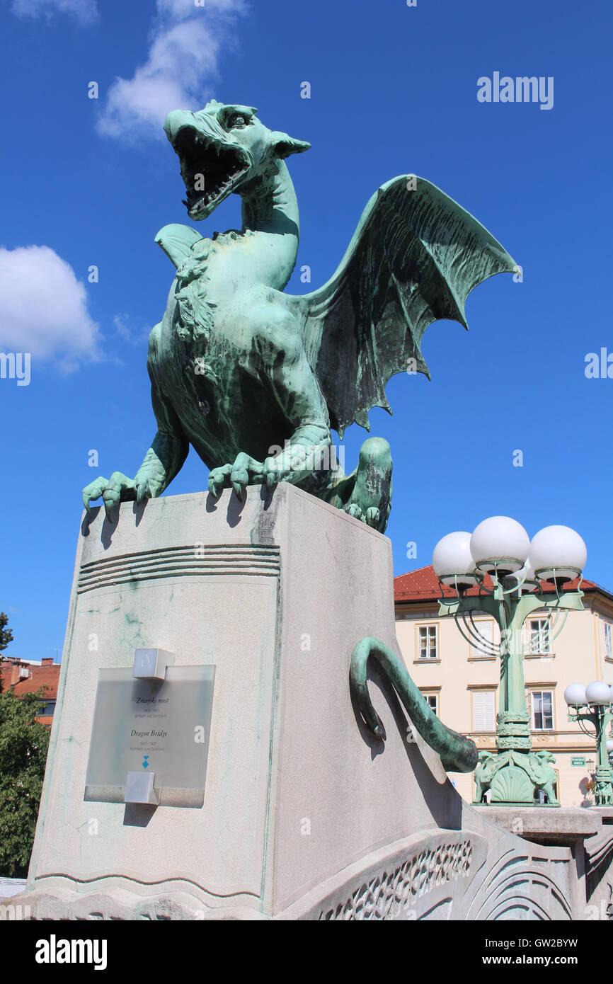 Dragon sculpture and plaque on the Dragon Bridge over the River Ljubljanica in Ljubljana city center, Slovenia. - Stock Image