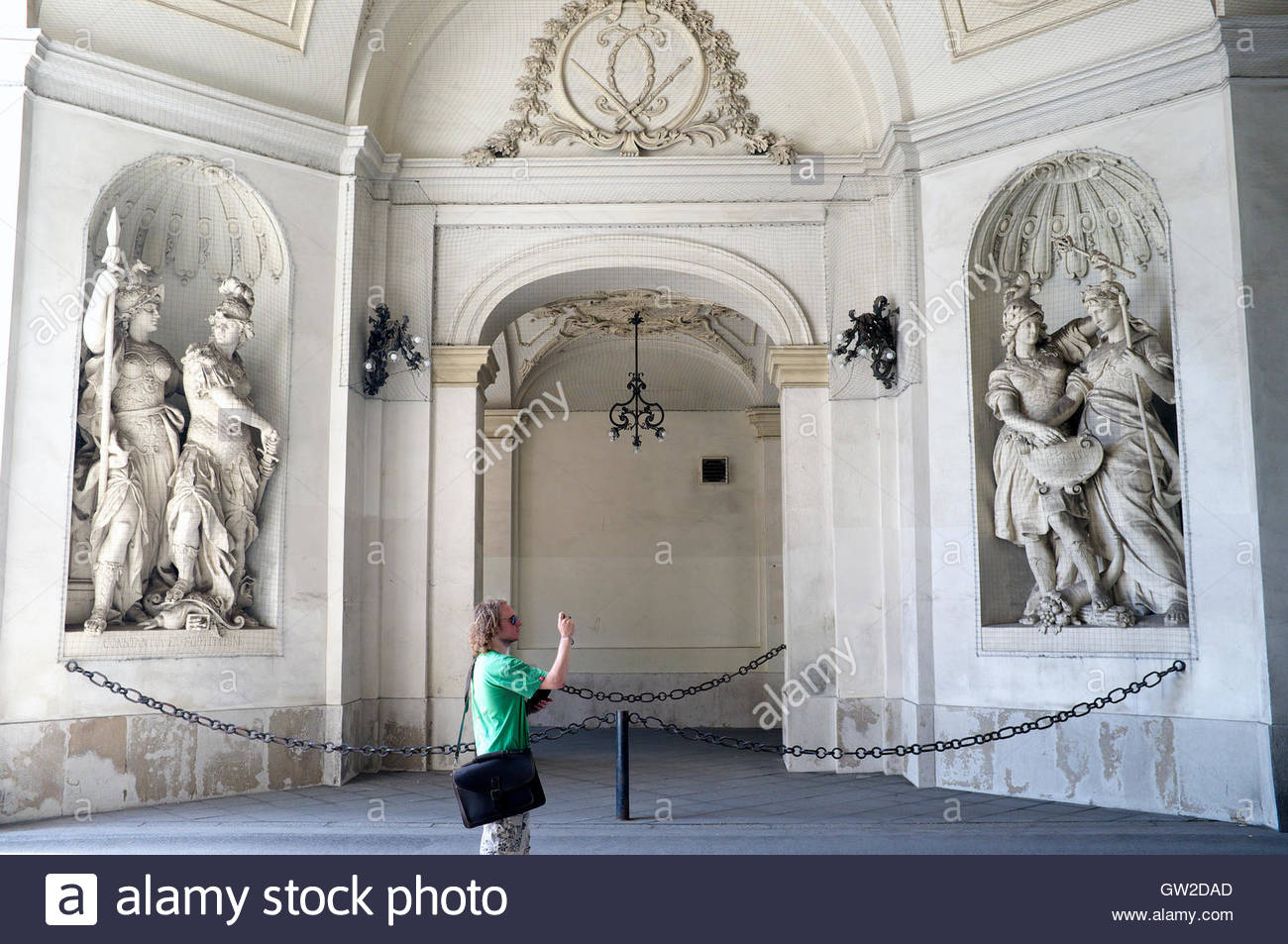 A tourist taking a photo at the Vienna Imperial Palace (Hofburg Palace). Vienna, Austria. - Stock Image