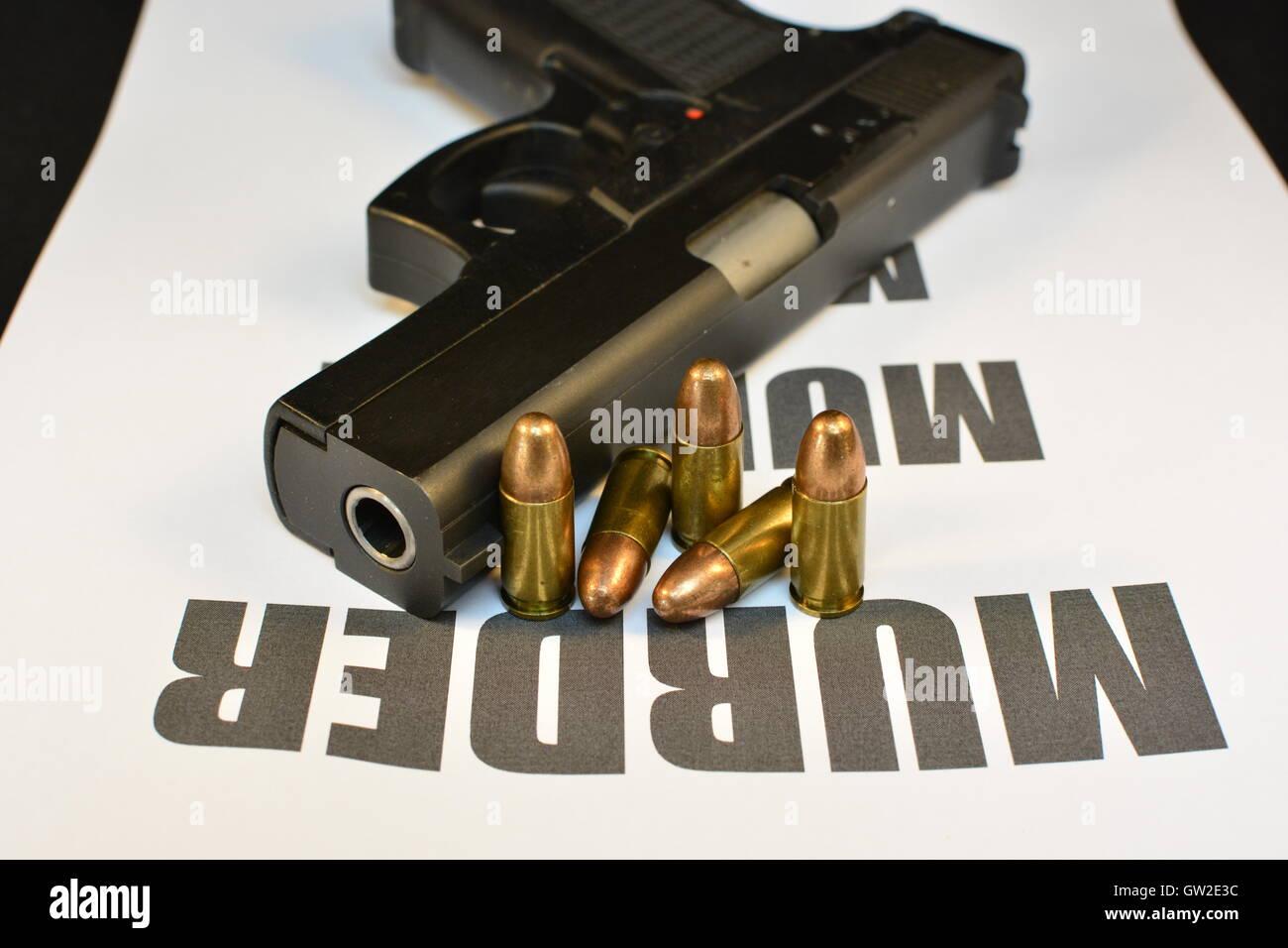 Crime Murder concept. Handgun with bullets. Gun violence. Shooting. - Stock Image