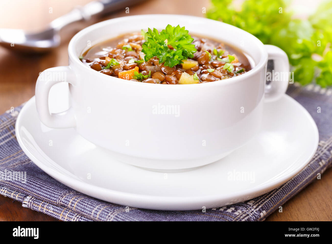 Fresh homemade lentil soup with potatoes and carrots Stock Photo
