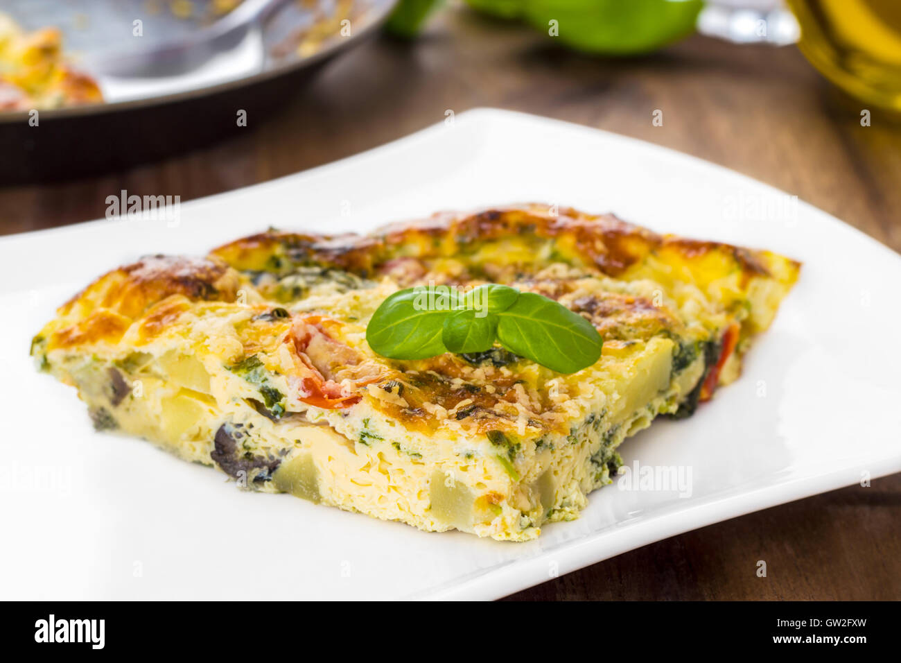 Italian frittata with vegetables and parmesan cheese - Stock Image