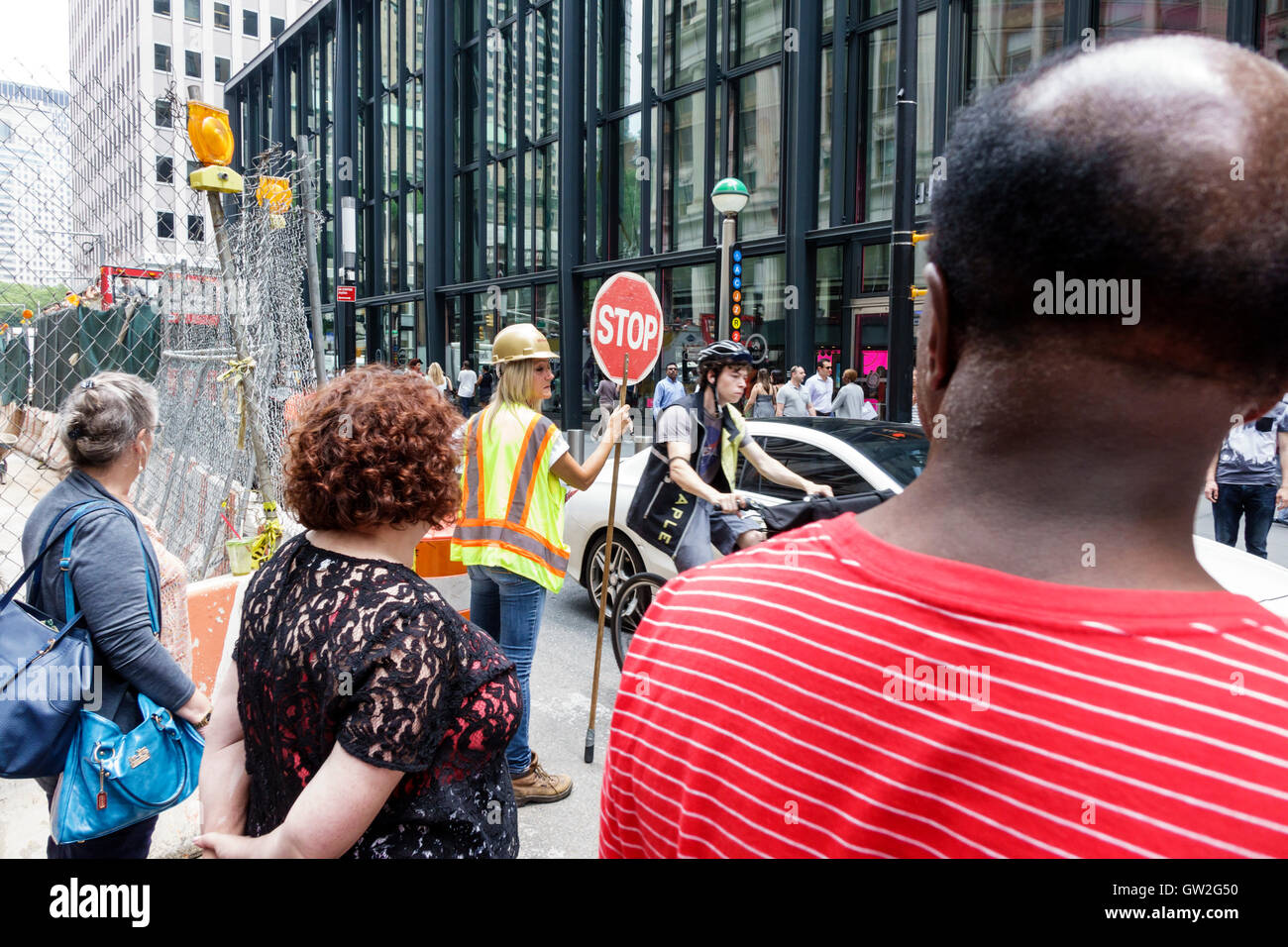 Lower Manhattan New York City NYC NY Financial District road construction pedestrian crossing traffic guard controller - Stock Image