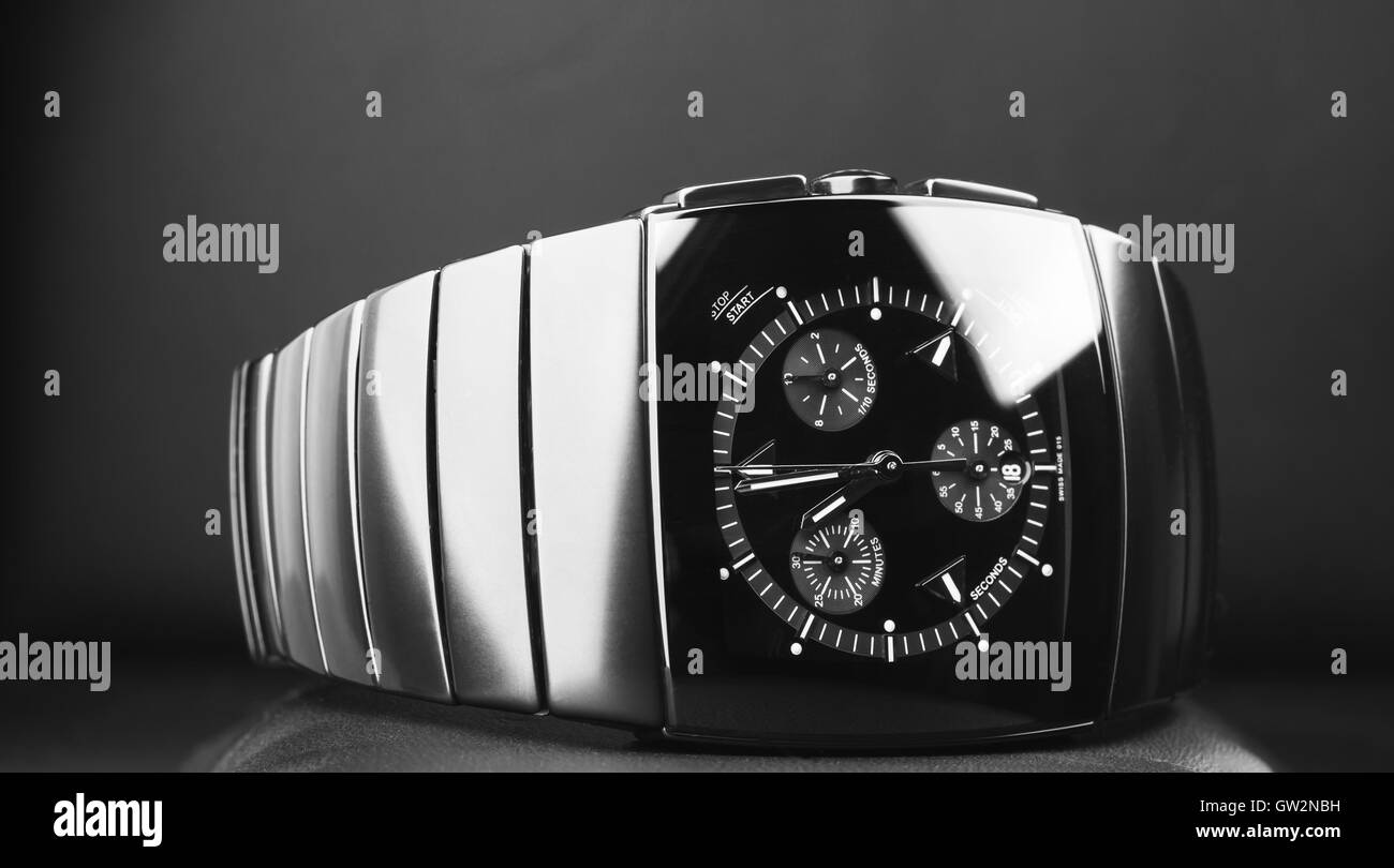Mens chronograph watch made of high-tech ceramics with sapphire glass over black background. Closeup photo, selective - Stock Image