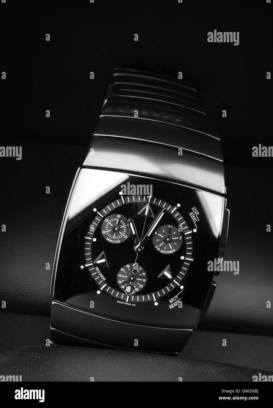 Mens chronograph watch made of high-tech ceramics with sapphire glass over black background. Selective focus - Stock Image