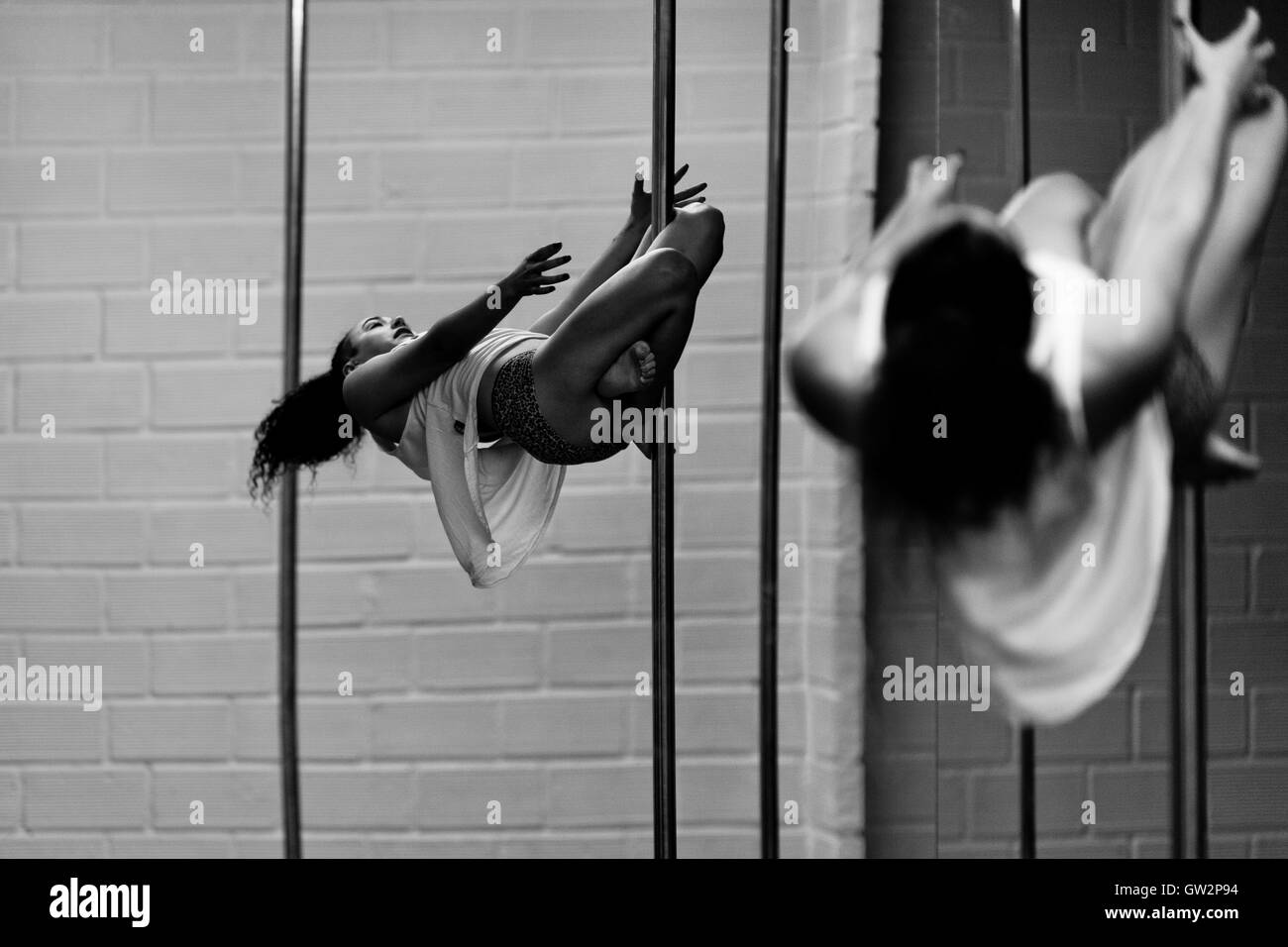 Carolina Echavarria, a young Colombian pole dancer, practices pole dance in Academia Pin Up, a dance studio in Medellín, - Stock Image