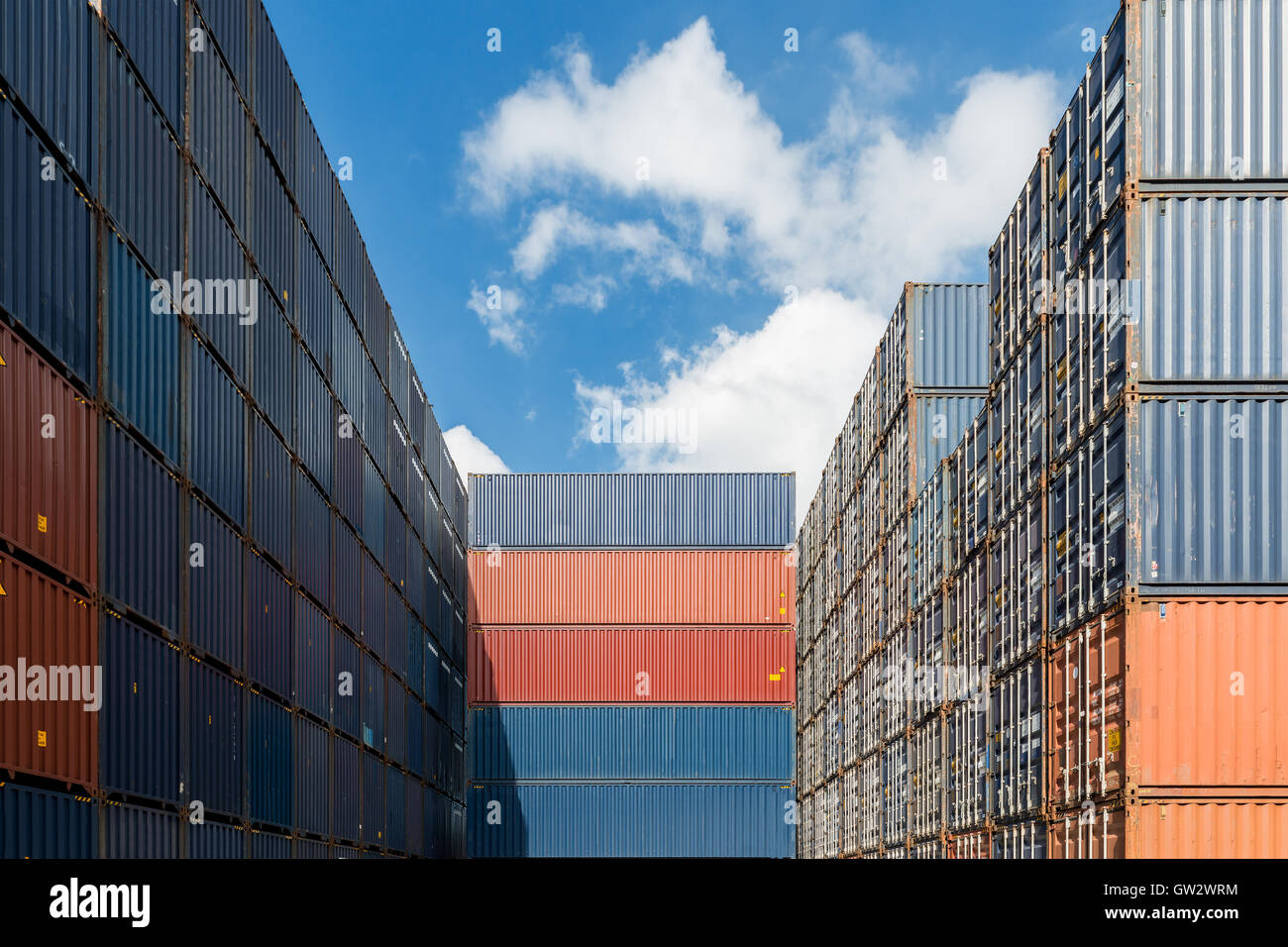 Stack of cargo containers at the docks use for import, export and logistics background - Stock Image