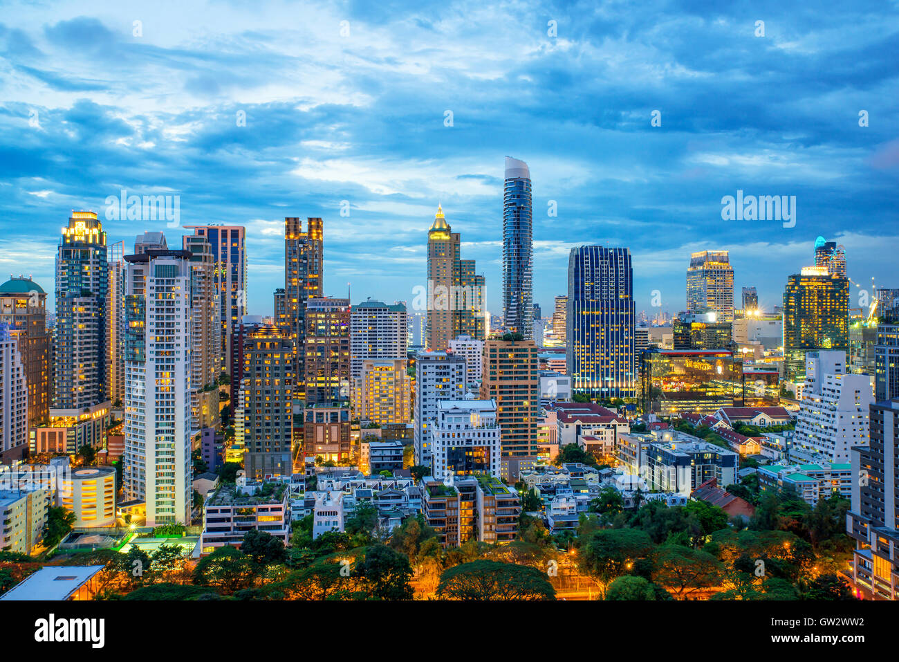 Bangkok city skyscrapers and Bangkok skyline at night in Bangkok, Thailand - Stock Image