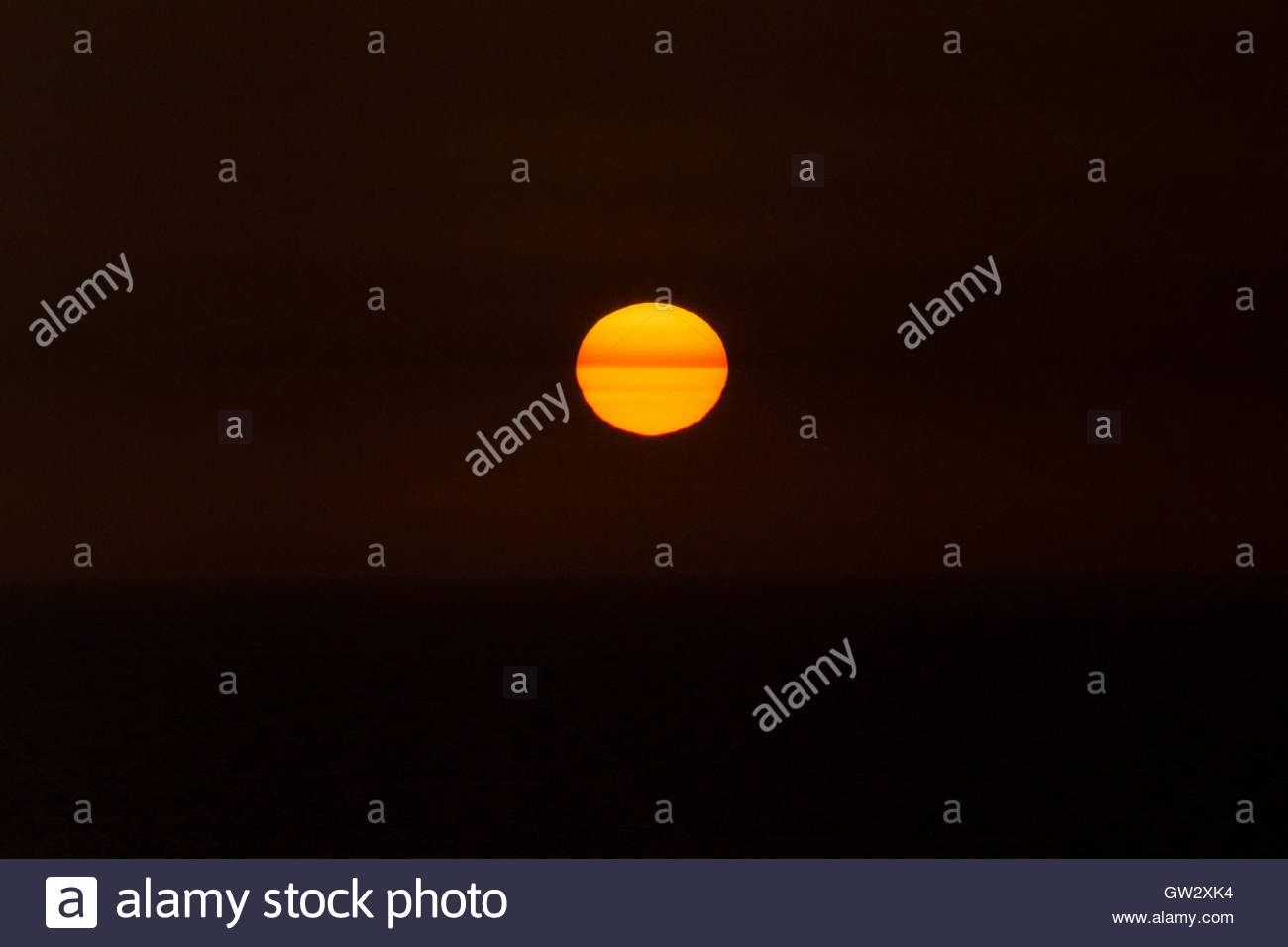 Underexposed sunset, spring in the Southern Hemisphere, Pacific Ocean, Lima, Peru - Stock Image