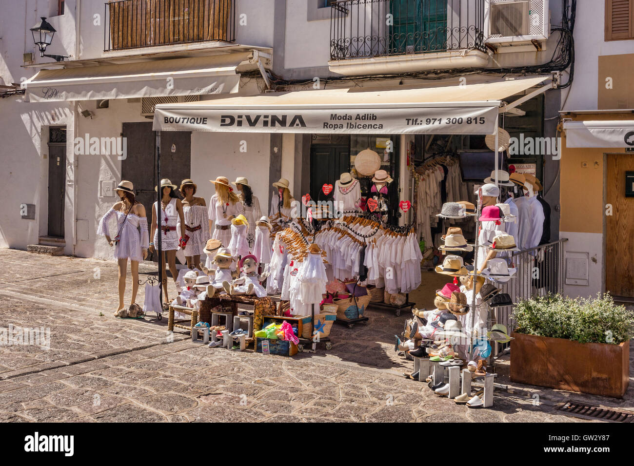 Divina boutique, selling womens and childrens clothing, in Ibiza Old Town, Ibiza, Spain. - Stock Image