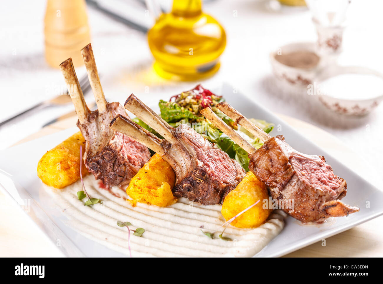 Gourmet main entree course grilled lamb steak Stock Photo