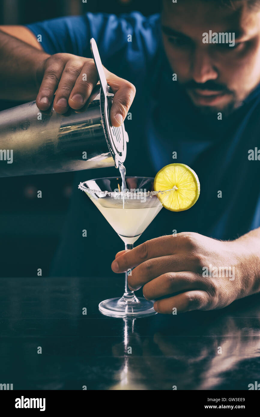 Barman making margarita cocktail, close up - Stock Image