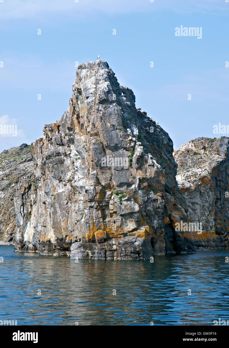 ocky cliff on the shore , Olkhon island, lake Baikal, Siberia, Russia - Stock Image