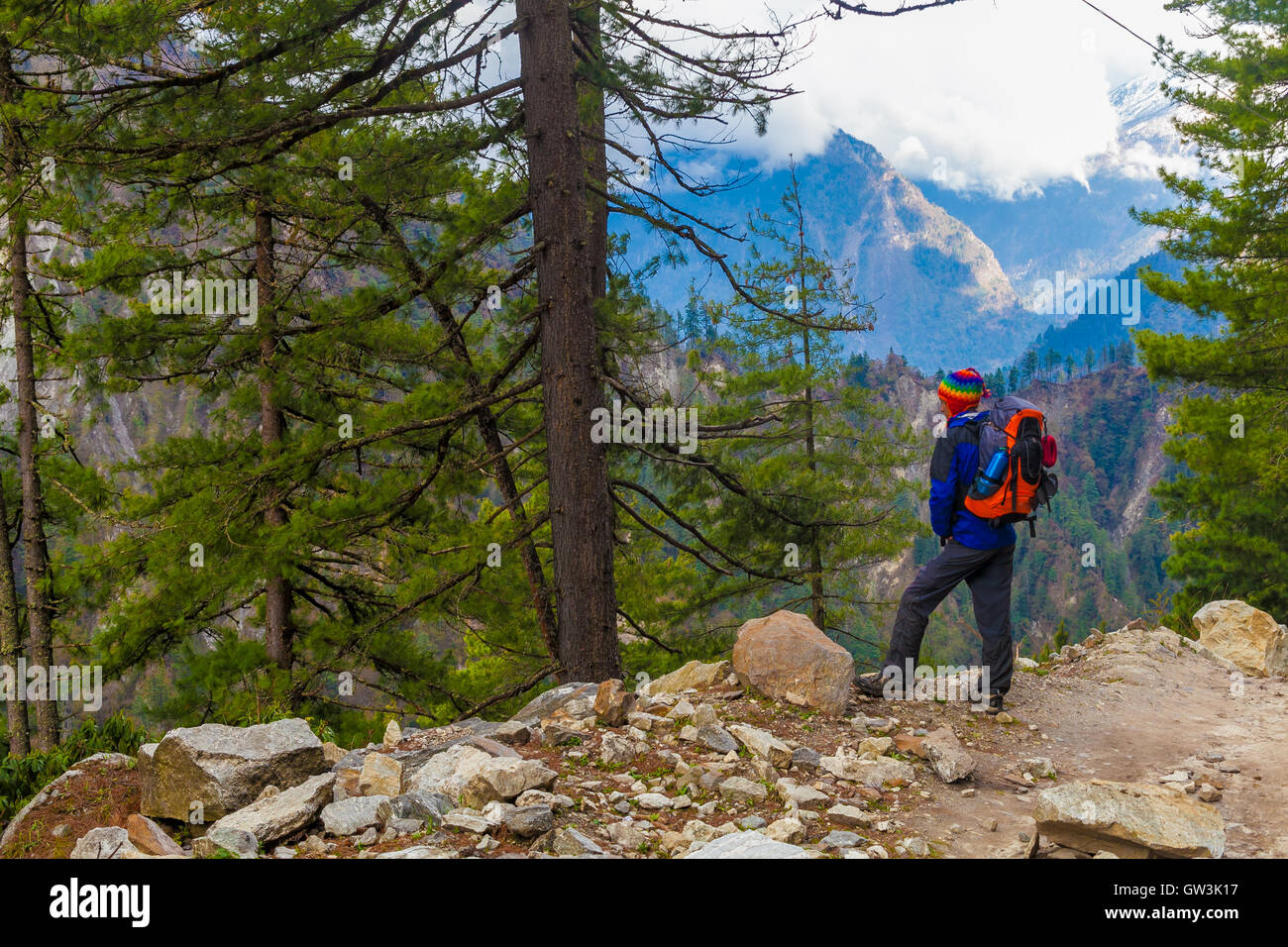Young Sport Man Wearing Jacket Backpack Trail Mountains.Mountain Trekking Rocks Path Landscape Beautiful View Background.Woman - Stock Image
