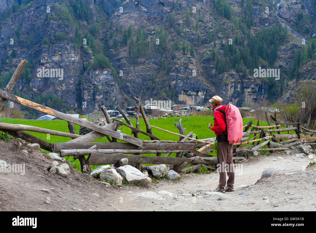 Photo young woman traveler with red backpack hiking in mountains beautiful himalayas summer landscape on background. - Stock Image