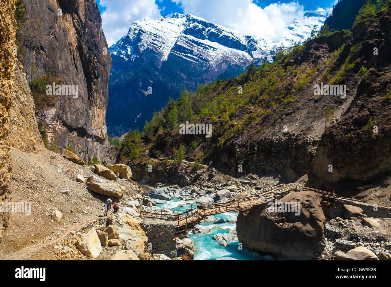 Landscape Fast Mountains River Hiking Himalayas.Beautiful View Wood Bridge End Summer Season Background.Green Threes - Stock Image