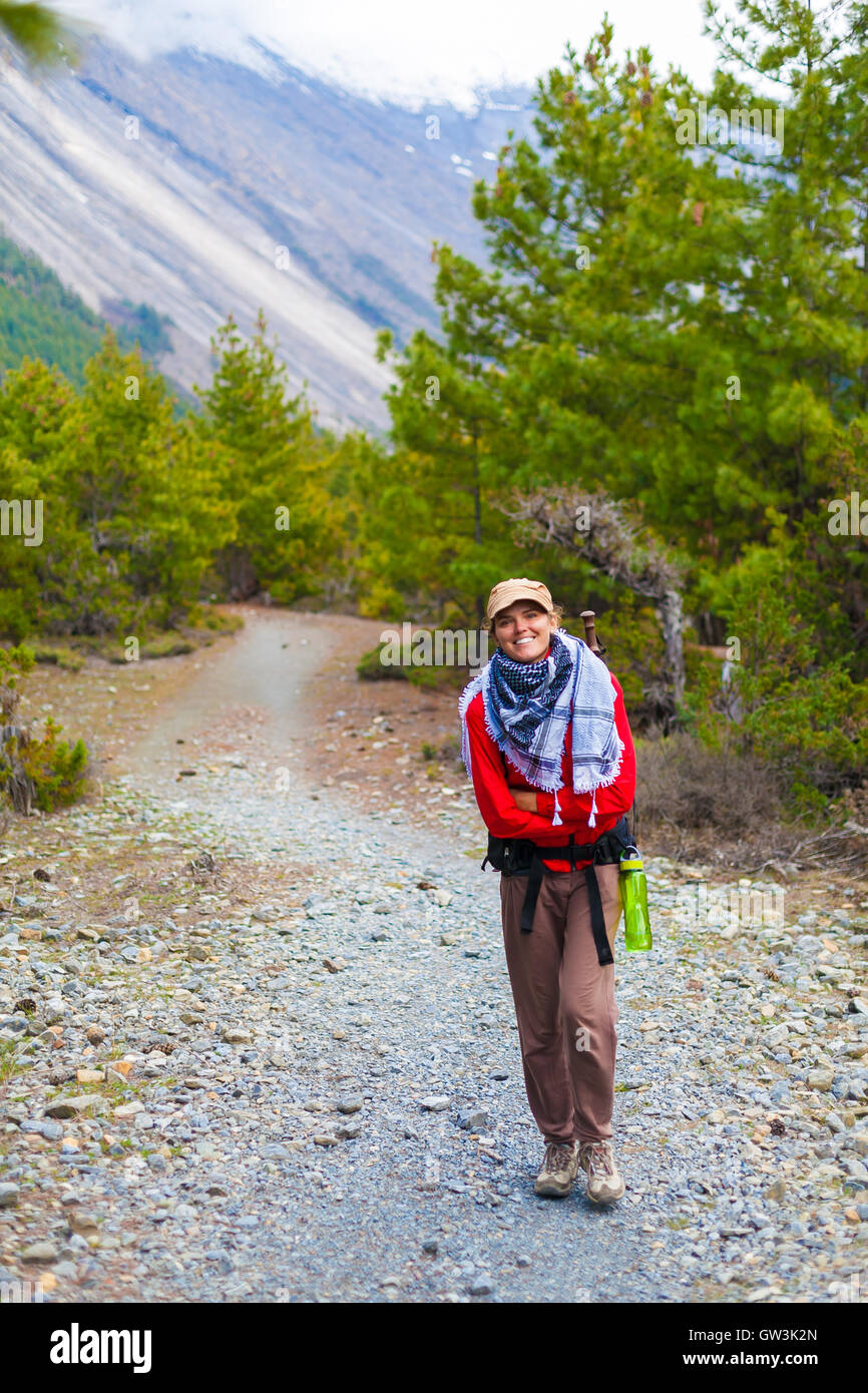 Portrait Young Pretty Girl Wearing Red Jacket Backpack Trail Mountains.Mountain Trekking Landscape Hikking Path - Stock Image