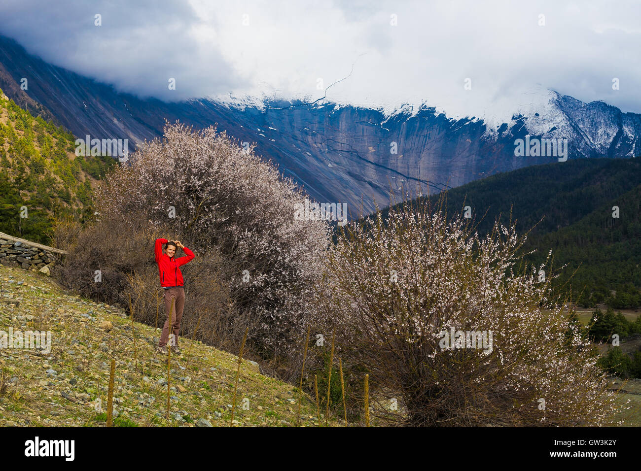 Portrait Young Pretty Girl Wearing Red Jacket Himalays Mountains.Asia Nature Morning Volcano Viewpoint.Mountain - Stock Image
