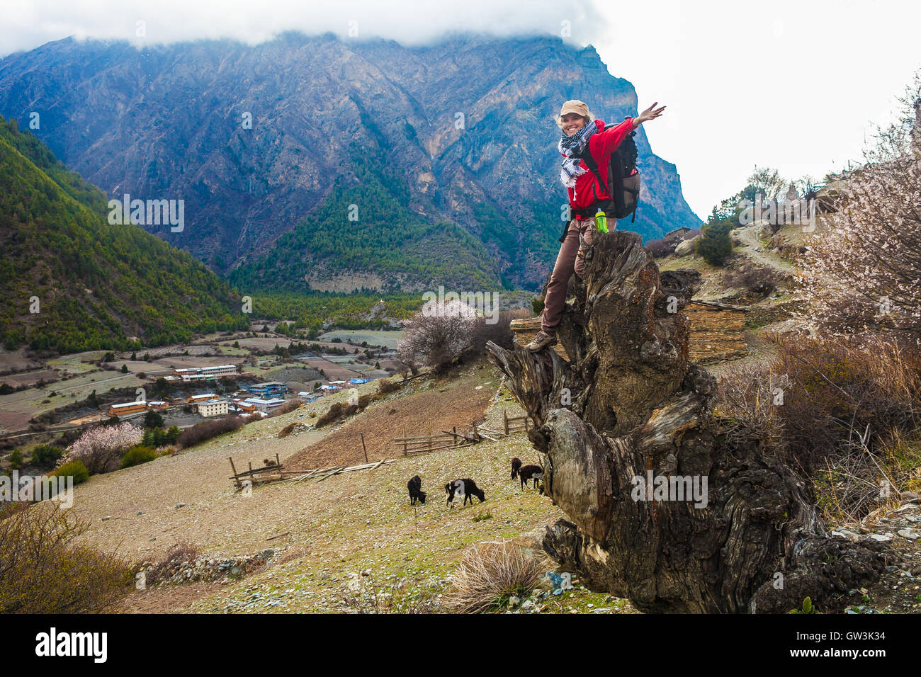 Portrait Young Pretty Girl Wearing Red Jacket Himalays Mountains.Asia Nature Morning Viewpoint.Mountain Trekking,View - Stock Image