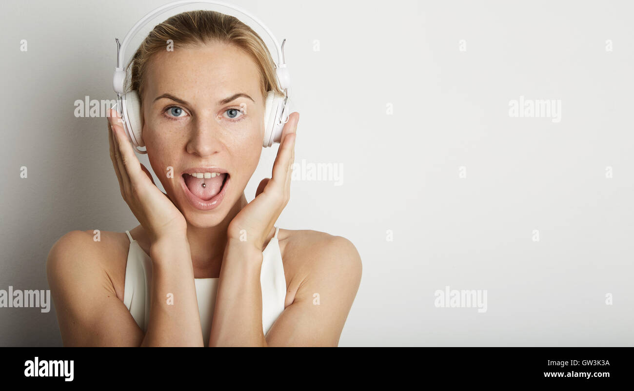 Portrait Handsome Young Woman Listening Music Player Headphones Blank White Background.Pretty Girl Enjoy Audio Smiling - Stock Image