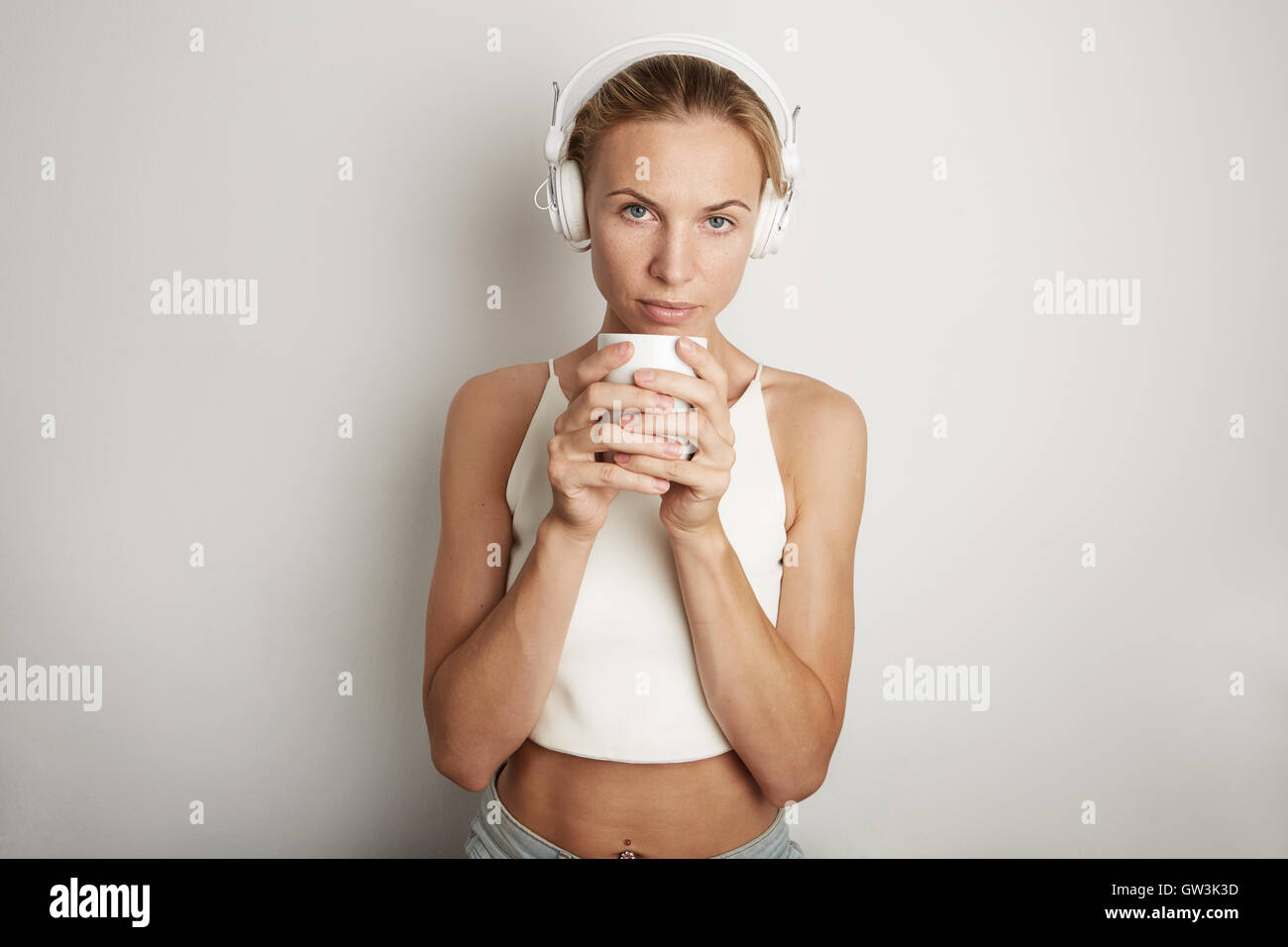 Portrait Handsome Young Woman Listening Music Player Headphones Blank White Background.Pretty Girl looking Holding - Stock Image