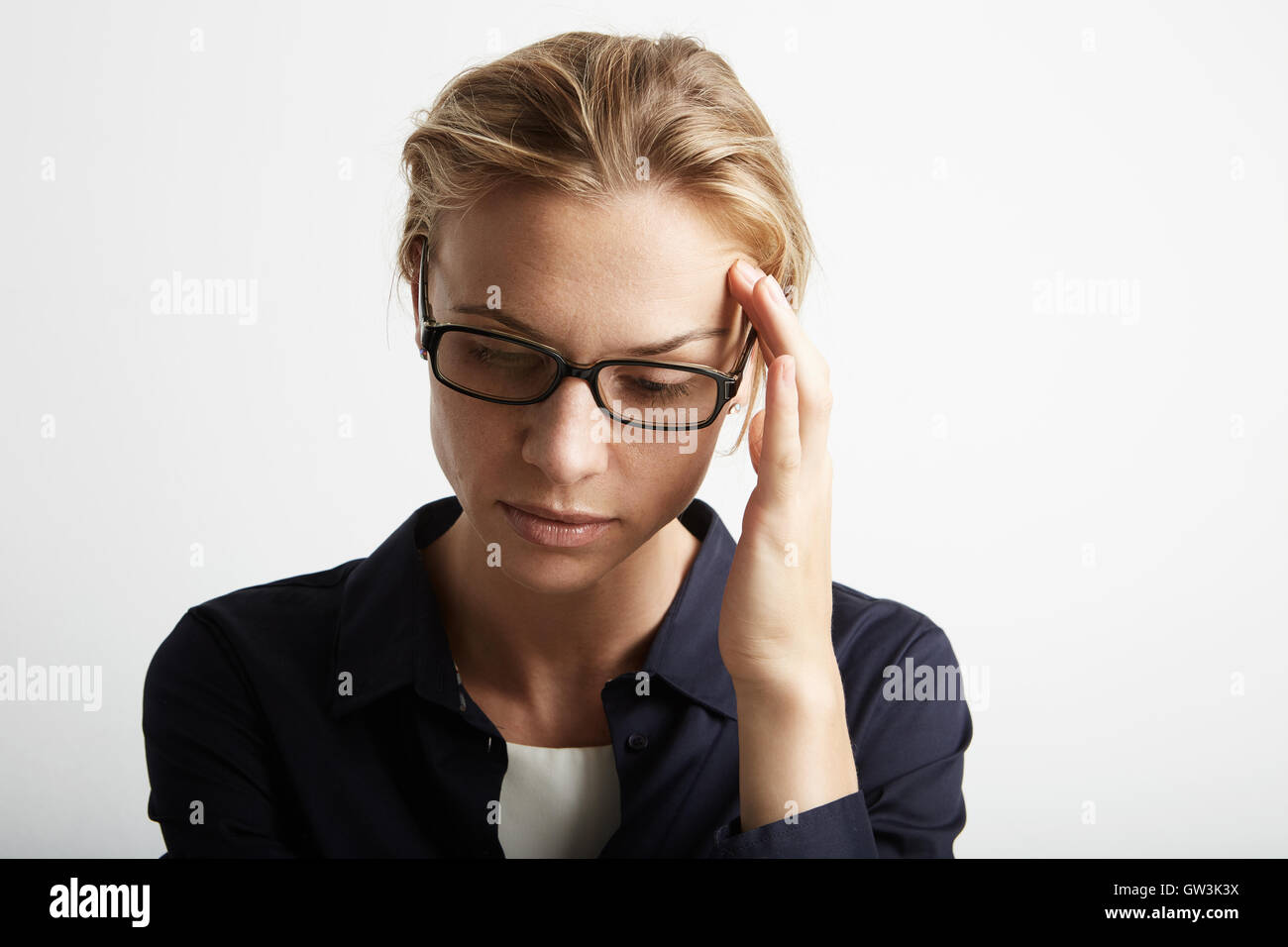 Portrait Handsome Pretty Young Woman Who Grabs Her Head Hands Headache.Empty White Background.Beauty,Crisis,Fashion - Stock Image