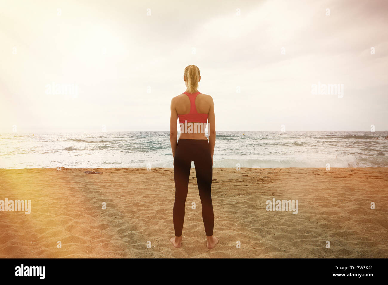 Young Sexy Girl Making Sport Workout Empty Sand Beach.Fitness Woman Spending Active Training Session Time Outdoor - Stock Image