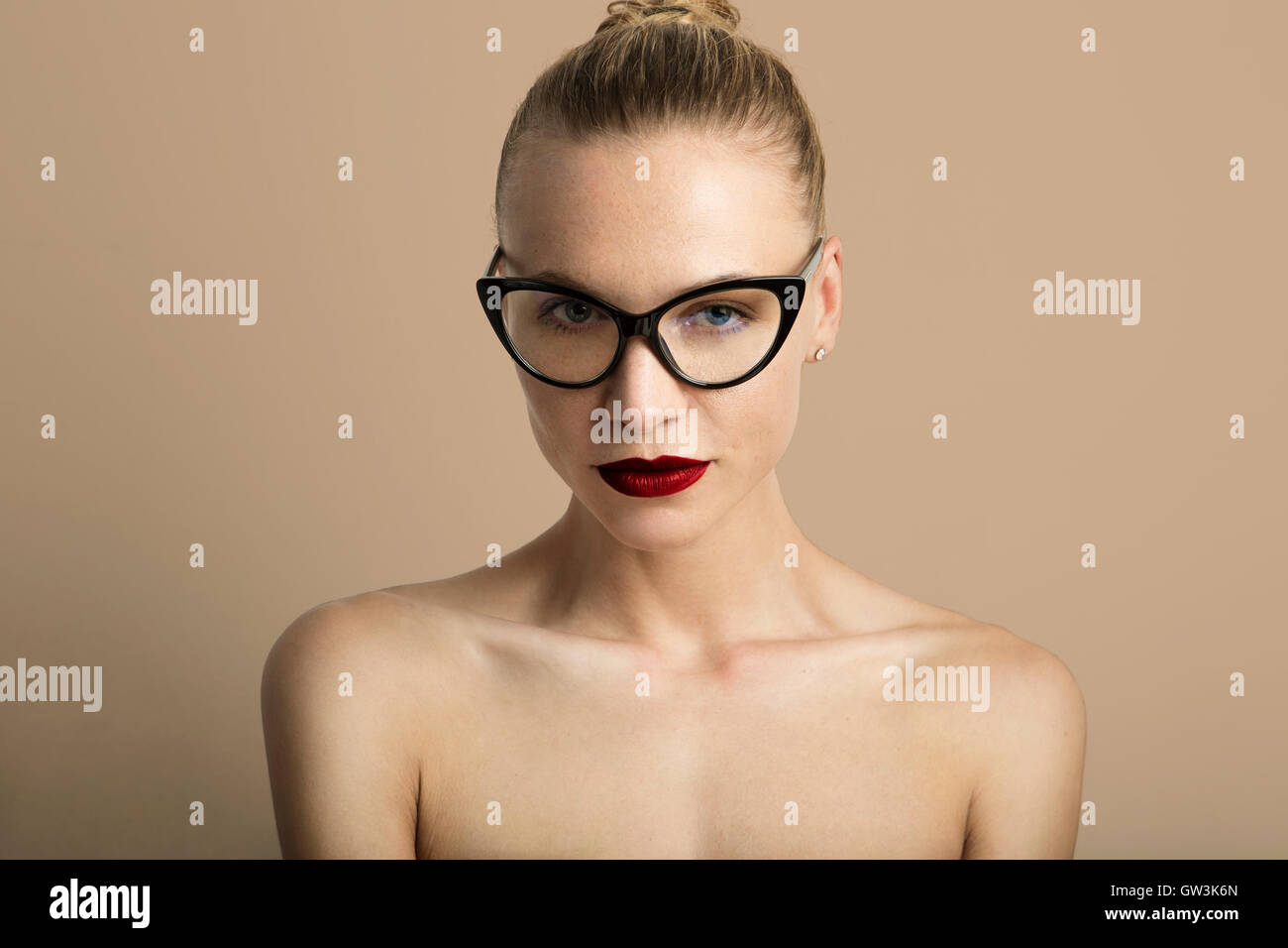 Portrait Handsome Pretty Young Lady Red Lips Wearing Black Classic Glasses Beige Color Empty Background.Beauty Loveliness - Stock Image