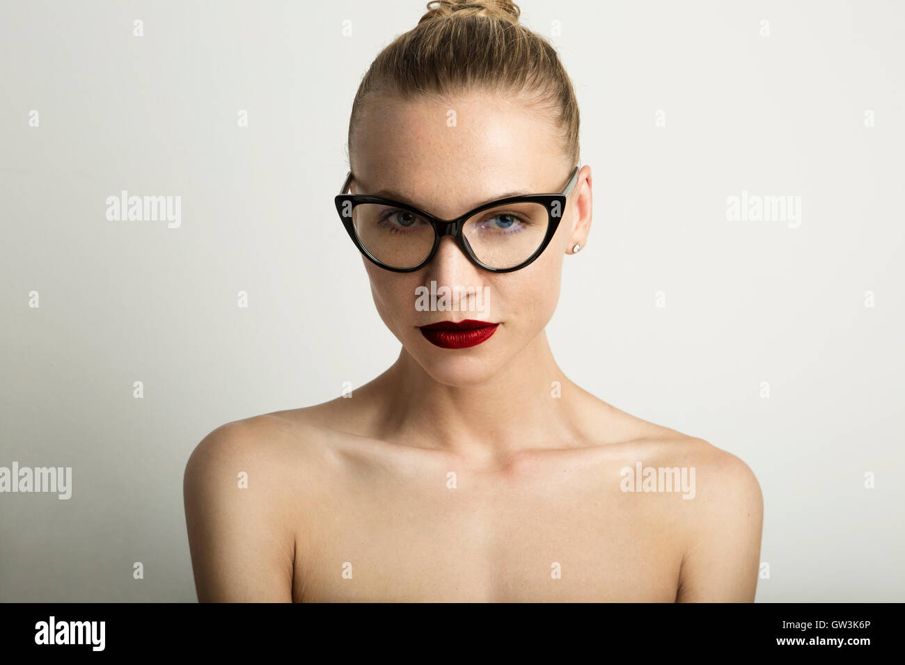 Portrait Handsome Pretty Young Lady Red Lips Wearing Black Classic Glasses White Color Empty Background.Beauty Loveliness - Stock Image