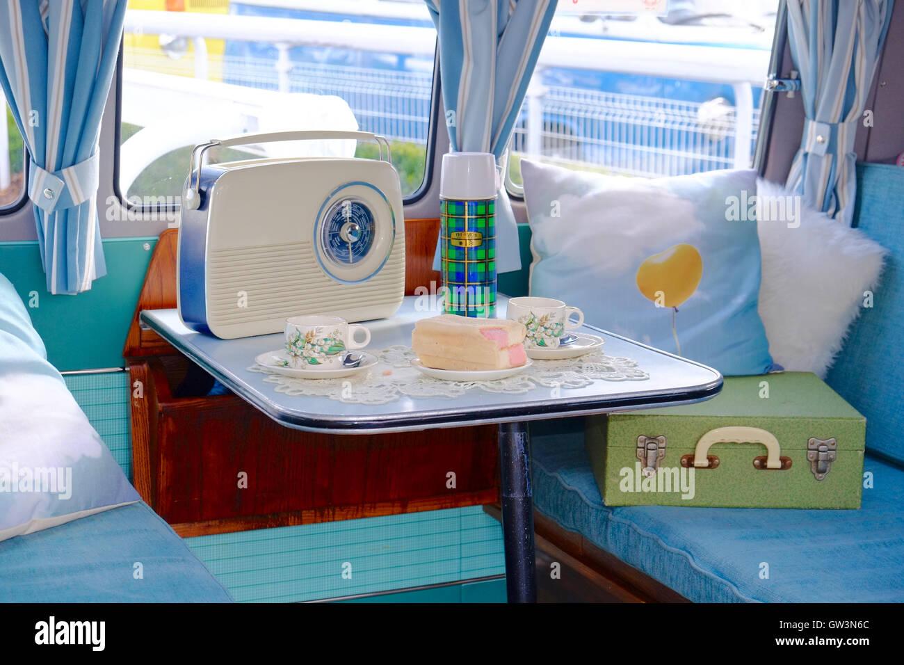 Volkswagen Camper-van Interior, set for afternoon tea and cake. - Stock Image
