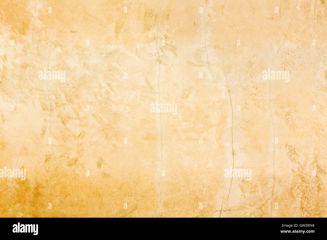 Rustic old aged gold stucco wall distressed background texture - Stock Image