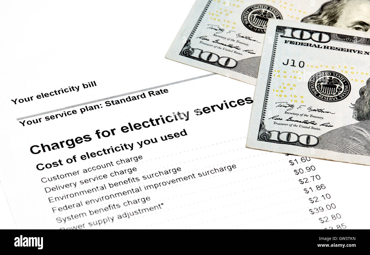 Charges for electricity services on a statement with US Currency - Stock Image