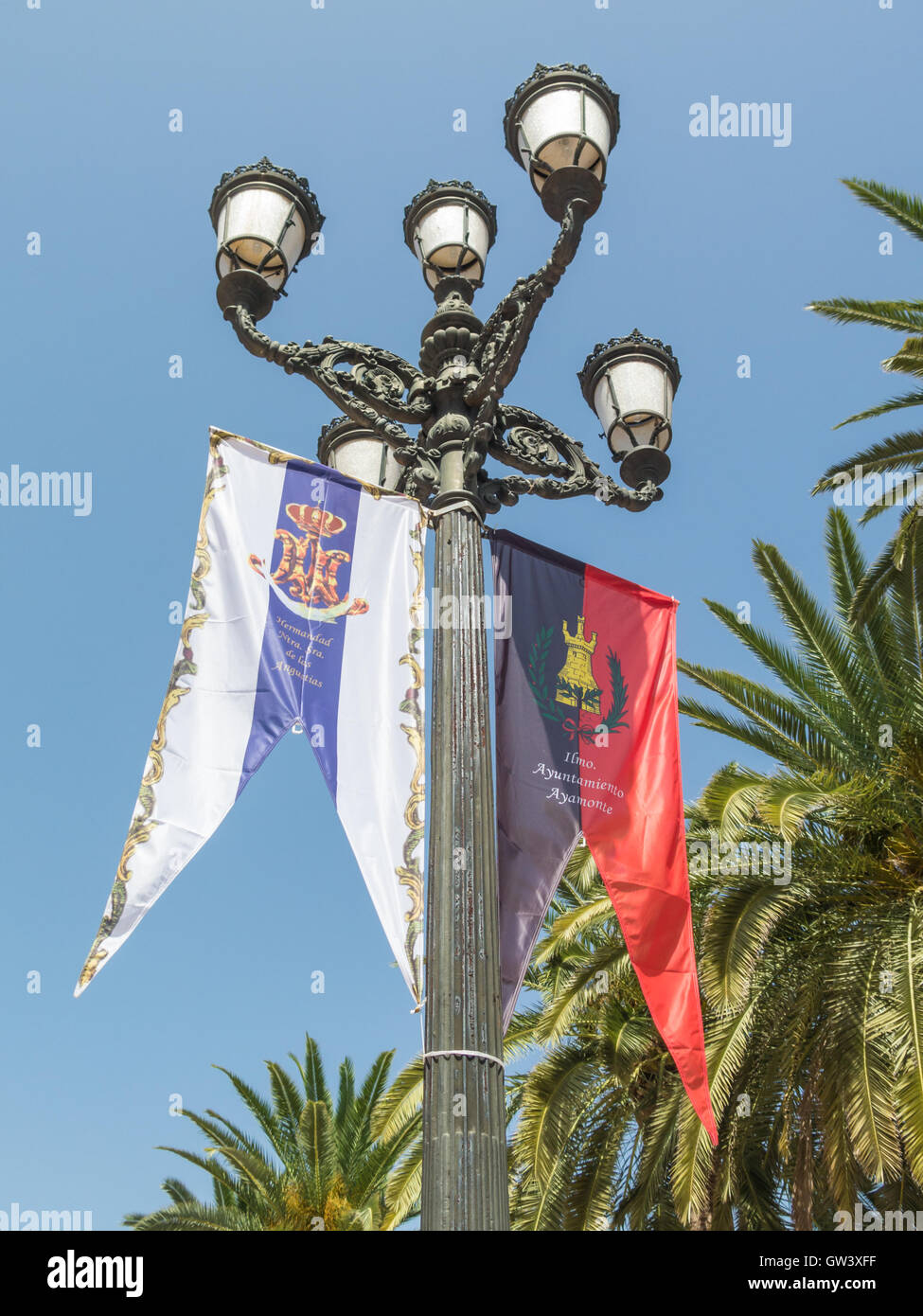 AYAMONTE, SPAIN - SEP 4 2016  Banners hung on lamposts in honor of the town and marking The Angustias Festival - Stock Image