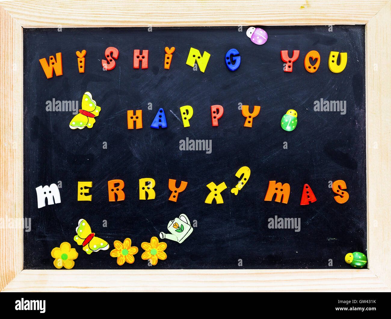 color merry christmas words on black board stock image