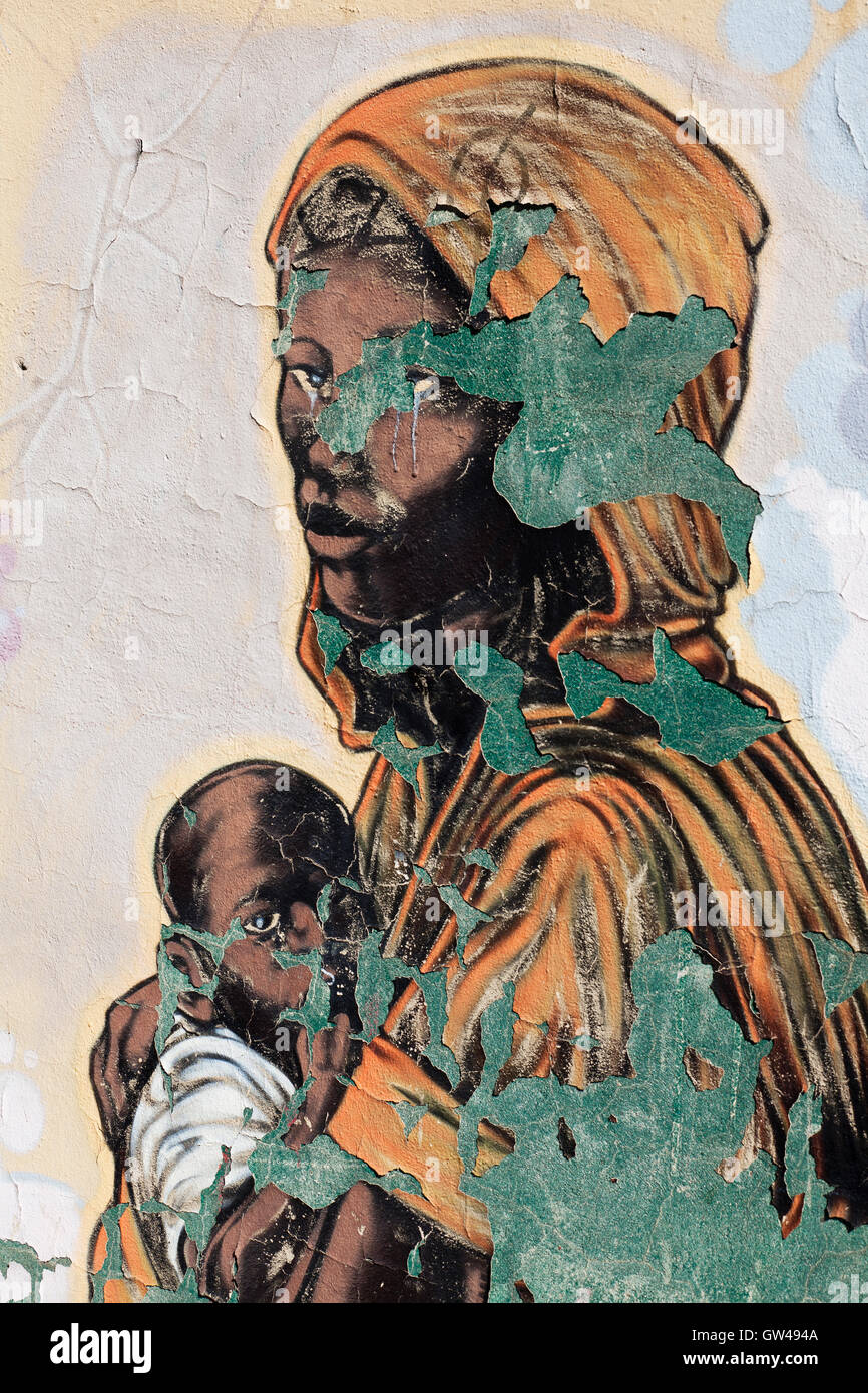 Black Madonna. Color photograph of wall artistic painting. - Stock Image