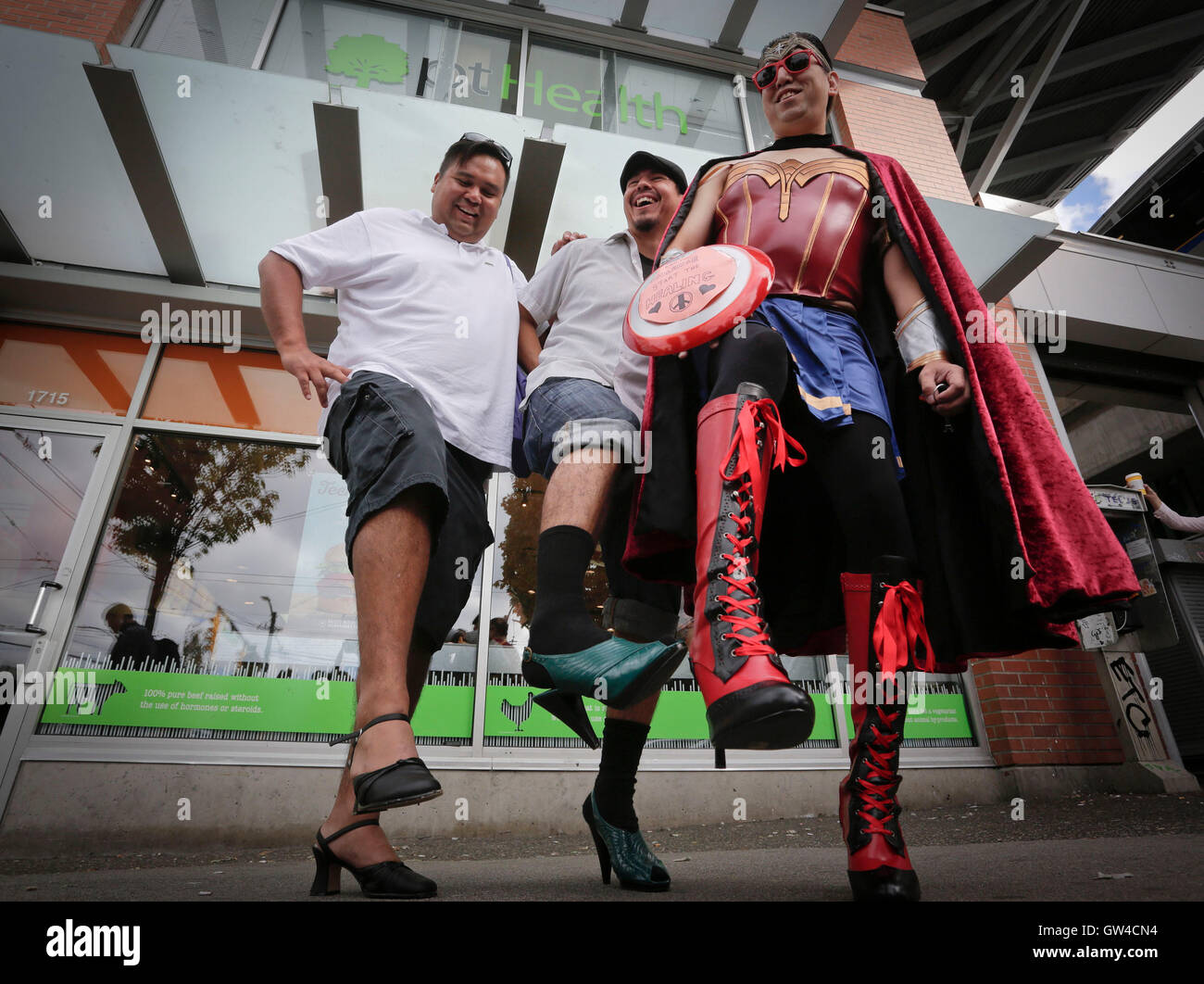Vancouver, Canada. 10th Sep, 2016. Participants display their high heels during the 'Walk A Mile in Her Shoes' - Stock Image