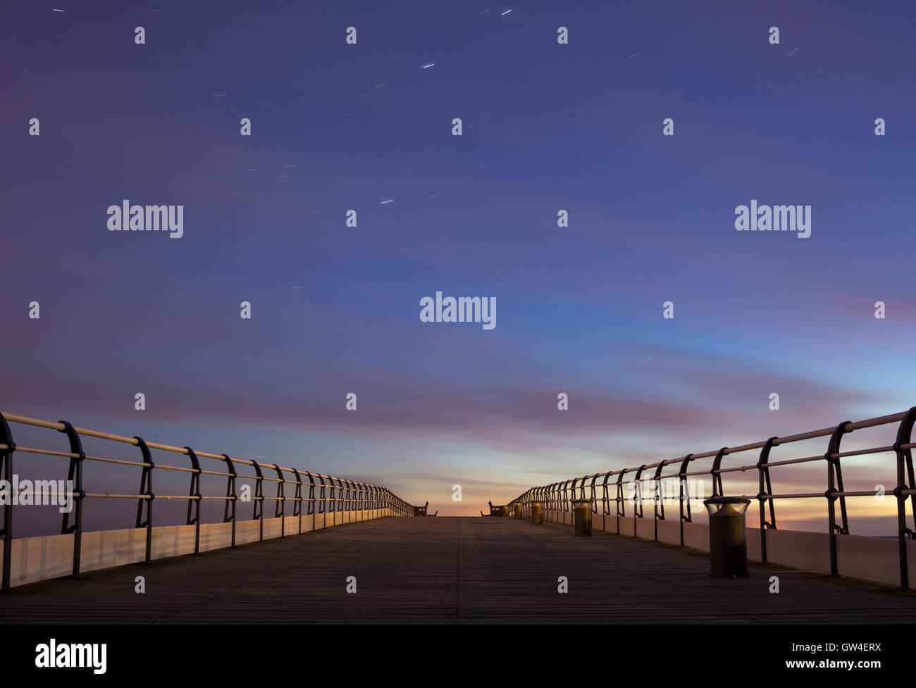 Pre dawn sky over Saltburn pier. Saltburn by the sea, North Yorkshire, England, UK. - Stock Image
