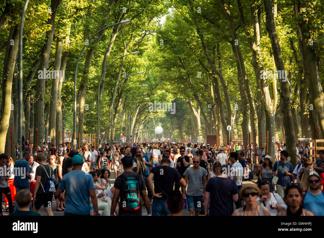 Visitors walking along the 'Walk of Stars', the main entrance of the Lollapalooza festival in Berlin, Germany, - Stock Image