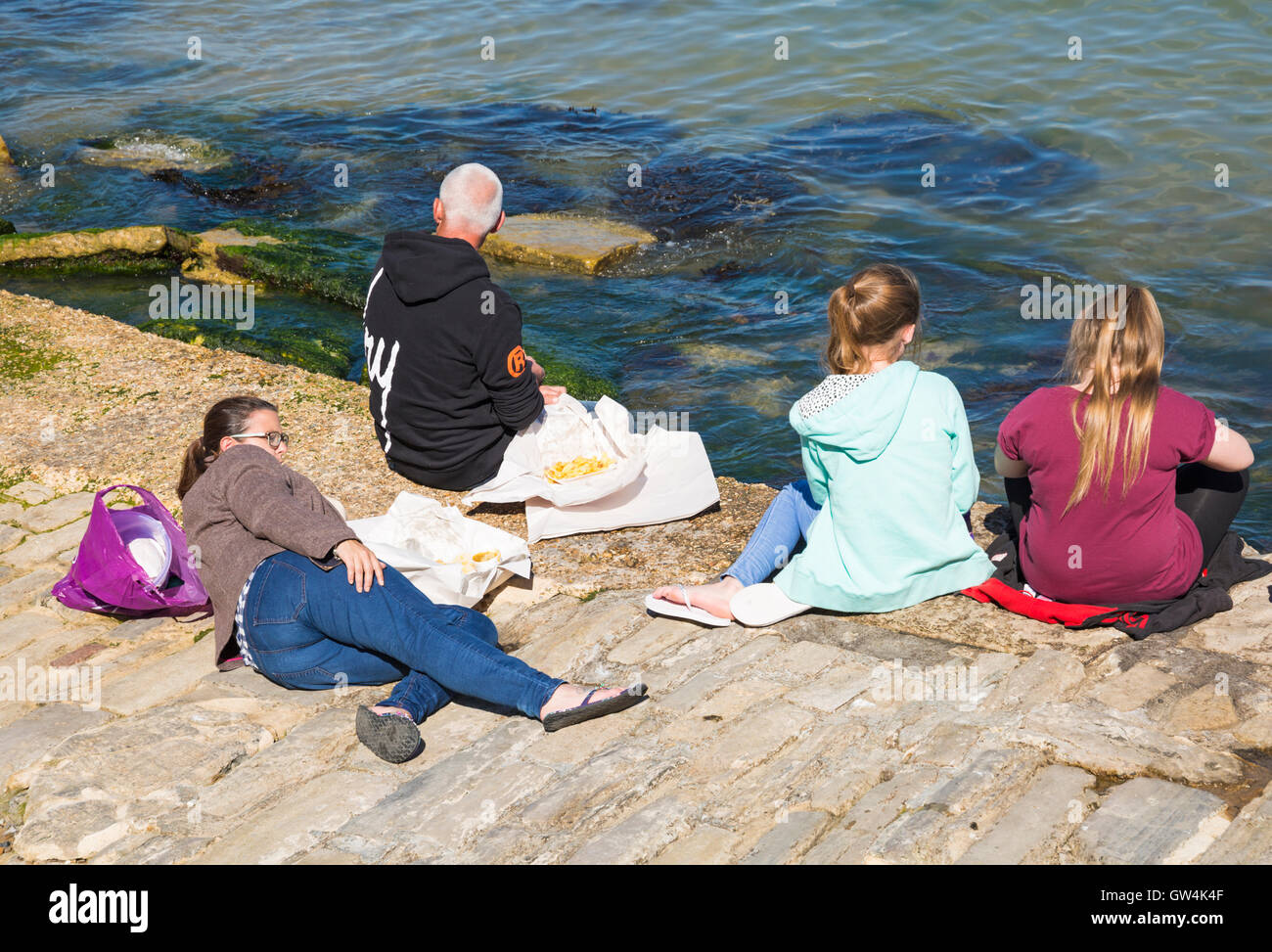 Swanage, Dorset, UK 11 September 2016. UK weather: glorious warm sunny day as visitors head for Swanage beach and - Stock Image