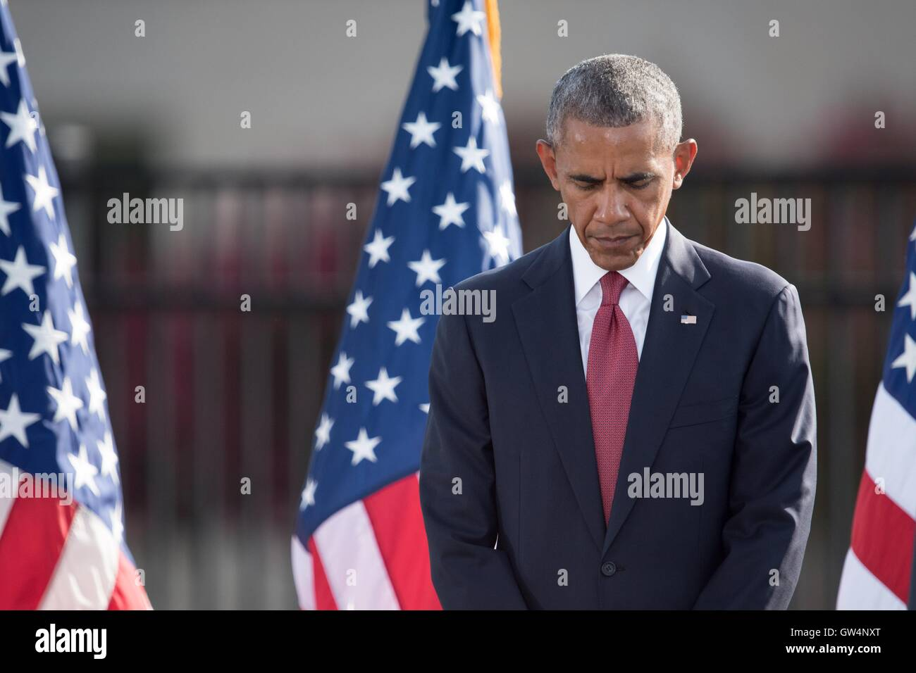 U.S President Barack Obama bows his head during a moment of silence at a remembrance ceremony commemorating the - Stock Image