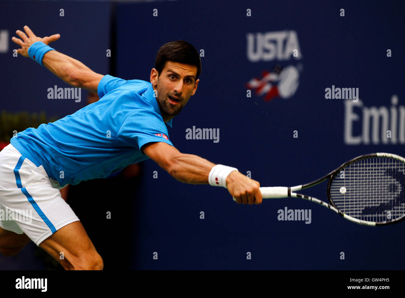 New York, United States. 11th Sep, 2016. Novak Djokovic lunges for a backhand return during the United States Open - Stock Image