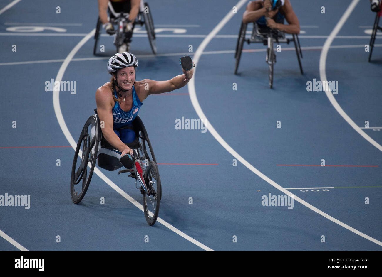 USA's Tatyana McFadden waves to crowd after wining the women's 400 meter T54 race at the Rio 2016 Paralympics. - Stock Image