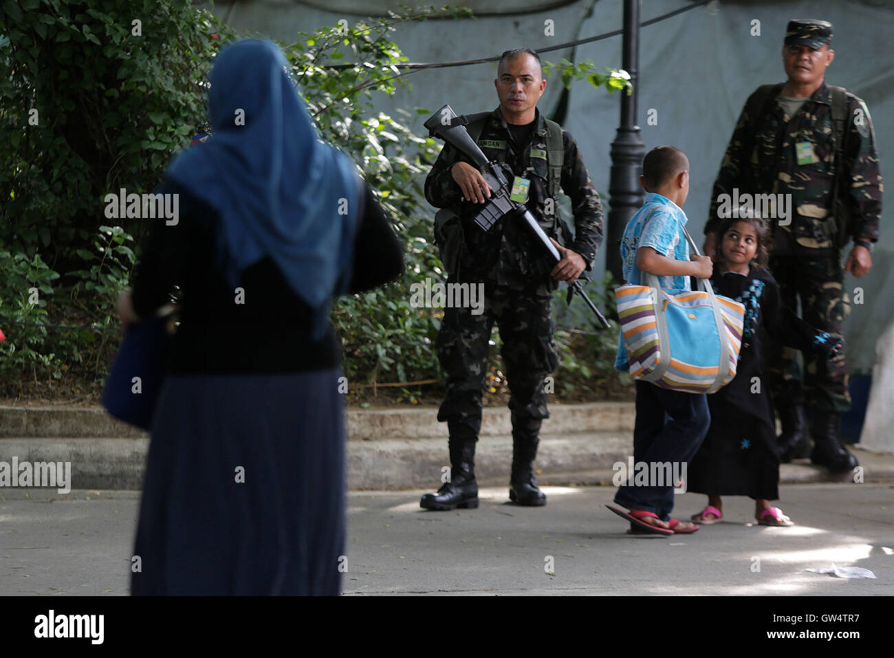 Quezon City, Philippines. 12th Sep, 2016. Soldiers of the Philippine Army patrol at the site of an Eid al-Adha celebration - Stock Image
