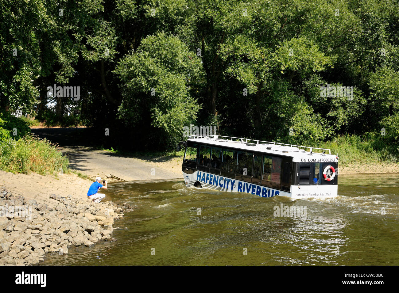Swimming Sightseeing-bus RIVERBUS  in the Elbe river, Entenwerder, Hamburg. Germany, Europe - Stock Image