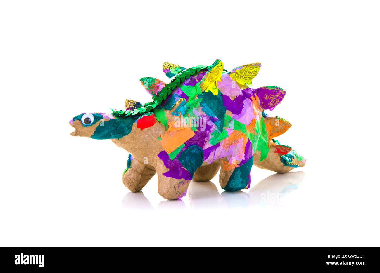 Colouful Hand Made Paper Mache Dinosaur on a White Background - Stock Image